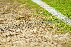Damaged turf on sideline of a stadium Royalty Free Stock Photo