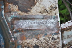 Damaged vehicle identification number. On the floor of old car Stock Photo