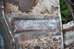 Damaged vehicle identification number Stock Photo