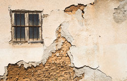 Damaged wall background with a closed window Royalty Free Stock Image