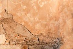 Damaged wall with bricks part showing closeup, background/ texture. stock photos