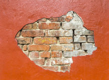 Damaged wall with bricks under Stock Image
