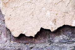 Damaged wall macro view. Textured vintage suface. Shallow depth of field, soft focus Royalty Free Stock Images