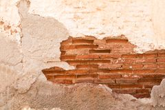 Damaged wall with red  brick part showing closeup, background/ texture. stock photos