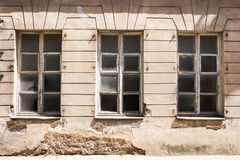 Damaged wall with windows. Stock Images