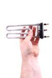 Damaged wash machine heater Royalty Free Stock Image