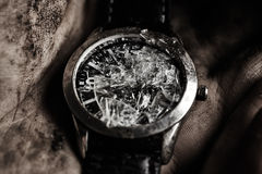 Damaged watch in hand Royalty Free Stock Image