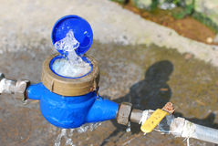 Damaged water meter. A damage of the water meter is a waste of resources Royalty Free Stock Photography