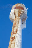 Damaged water tower Stock Photo