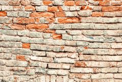 Damaged and weathered old brick wall Royalty Free Stock Photo