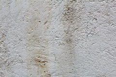Damaged wet white stucco plaster texture Royalty Free Stock Image