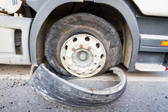 Damaged 18 wheeler semi truck burst tires by highway street Royalty Free Stock Photo