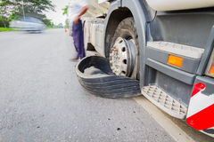 Damaged 18 wheeler semi truck burst tires by highway street, wit Royalty Free Stock Photography