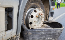 Damaged 18 wheeler semi truck burst tires by highway street, wit Royalty Free Stock Image