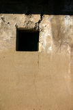 Damaged window (vertical). Damaged window; peace after a war zone (vertical stock photo