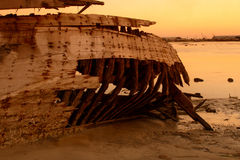 Damaged wooden boat daw Stock Images