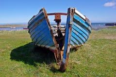 Damaged wooden boat Stock Photo