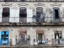 DAMAGED WOODEN DOORS AND WINDOWS ON OLD FACADE, HAVANA, CUBA Royalty Free Stock Photos