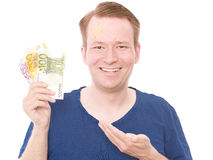 Damages. Young happy smiling man with a plaster on his forehead holding some euro banknotes for your compensations concepts - isolated on white and retouched Royalty Free Stock Photography