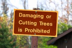A Damaging or Cutting Trees is Prohibited sign.  Royalty Free Stock Image