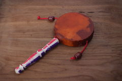 Damaru drum percussion instrument with a handle Royalty Free Stock Images