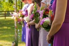 Damas de honor de un detalle del ramo de la boda Fotografía de archivo libre de regalías