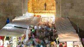 Damascus Gate entrance timelapse Old City Jerusalem Palestine Israel night light long exposure motion blur. Crowd on market at ramadan stock video