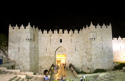 Damascus Gate Old City Jerusalem night light. Damascus Gate entrance Old City Jerusalem Palestine Israel  night light long exposure motion blur faces Stock Images