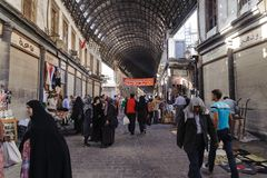 DAMASCUS, SYRIA - NOVEMBER 16, 2012: Ordinary day at Al-Hamidiyah Souq in the old city of Damascus. Bazaar is the largest souk in Stock Photography