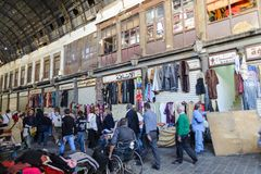 DAMASCUS, SYRIA - NOVEMBER 16, 2012: Ordinary day at Al-Hamidiyah Souq in the old city of Damascus. Bazaar is the largest souk in Royalty Free Stock Image