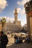 DAMASCUS, SYRIA - NOVEMBER 16, 2012: Umayyad Mosque minaret from Al-Hamidiyah Souq in the old city of Damascus. The Minaret of Qai Stock Image