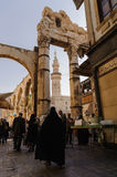 DAMASCUS, SYRIA - NOVEMBER 16, 2012: Umayyad Mosque minaret and ruins from Al-Hamidiyah Souq in the old city of Damascus. The Mina Royalty Free Stock Images