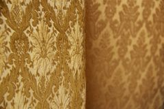 Damask. Is a reversible figured fabric of silk, wool, linen, cotton, or synthetic fibers, with a pattern formed by weaving. s are woven with one warp yarn and stock images