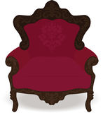Damask armchair. Pink damask armachair with wooden arms Royalty Free Stock Photography