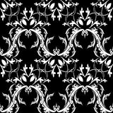 Damask baroque floral seamless pattern. Black white background w. Allpaper with scroll leaves, damask flowers and antique Baroque ornaments. Vintage  design for Royalty Free Stock Photos