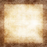 Damask Floral Border. Floral swirls grungy damask border background frame in faded brown tones Stock Photo