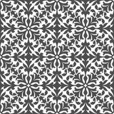 Damask floral seamless pattern with gray foliage. Damask floral seamless pattern with gray arabesque ornament of scrolling and interlacing leaves on white Stock Image