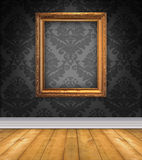 Damask Room With Empty Picture. Elegant, moody room with black damask wallpaper and ornate empty picture frame Stock Images