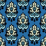 Damask seamless ornamental vector. Blue Damask seamless ornamental motif vector background Royalty Free Stock Images