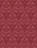Damask seamless wallpaper. In red palette Royalty Free Stock Photo