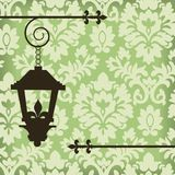 Damask with vintage lamp Royalty Free Stock Photography
