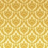 damastast guld Arkivfoto