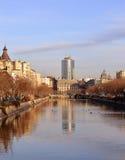 Dambovita River and Bucharest Financial Plaza Stock Photo