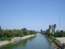 Dambovita river viewed from Ciurel bridge in Bucharest. With bridge pillar under construction on the right Royalty Free Stock Photos