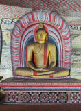 In the Dambulla cave temple. Ancient Buddha Statue Royalty Free Stock Photos