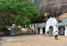 Dambulla golden temple cave complex buildinds is destination for Stock Images