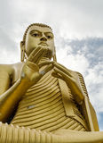 Dambulla Golden Temple with a huge Buddha statue Royalty Free Stock Photo