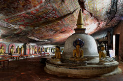 Dambulla Golden Temple in Sri Lanka. Inside this famous temple, the rock paintings belong to the Unesco World List stock photography