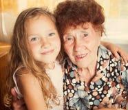 Dame âgée avec l'arrière-petit-fils Photographie stock libre de droits
