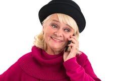 Dame âgée avec le sourire de téléphone portable Images stock